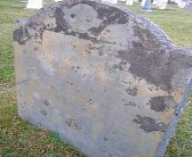 The Samuel Mack grave marker with a winged death's head image in the Old Port Medway Cemetery, Port Medway, NS.; NS Dept. of Tourism, Culture & Heritage, 2009