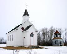 Contextual view, from the southeast, showing the church building and bell tower of Sts. Peter and Paul Roman Catholic Church, Elphinstone area, 2006; Historic Resources Branch, Manitoba Culture, Heritage and Tourism, 2005
