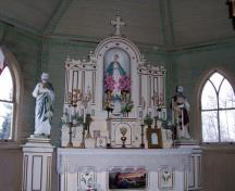 Interior view of the altar in Sts. Peter and Paul Roman Catholic Church, Elphinstone area, 2006; Historic Resources Branch, Manitoba Culture, Heritage and Tourism, 2005