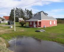 A northwest perspective view of the Little School Museum in its setting in the Town of Lockeport, NS.; NS Dept of Tourism, Culture & Heritage, 2009