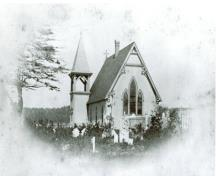 This historic image of the Church of Ascension in North Head, Grand Manan, shows the eastern wall of the church and it's spectacular stained glass windows.; Grand Manan Archives - Wooster image