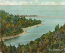 This image is an old colored postcard showing Dark Harbour Pond from the eastern shore looking west. The steep cliffs and the pond with its seawall are visible. ; Grand Manan Archives