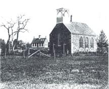 Historic image of St. Paul's Anglican Church with the original Grand Harbour School in the background. The school is across the brook. ; Grand Manan Archives
