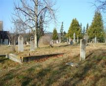The Old North Head Cemetery has low cement walls leveling some family plots. Most of the cemetery is level with roads throughout.; Grand Manan Historical Society