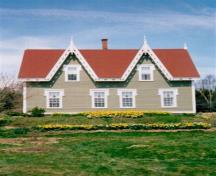 Image of the Isaac Newton House in the spring of 2000 with daffodils in bloom. This image was taken after many years of restoration to this old home.; Dale Brown