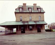 General view of the side elevation of the Newfoundland Railway Headquarters National Historic Site of Canada terminus building, 1997.; Public Works and Government Services Canada / Travaux publics et Services gouvernementaux Canada, 1997.