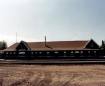 General view of VIA Rail/Canadian National Railways Station at Portage la Prairie, showing the track-side façade, 1992.; Agence Parcs Canada / Parks Canada Agency, 1992.