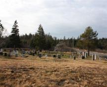 This photo, taken in the fall of 2009, looks down on the cemetery from the original location of the Seal Cove Baptist Church (no longer there); Grand Manan Historical Society