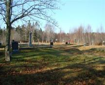 The cemetery is on level gound with some plots terraced and fenced with low cement walls and iron railings; Grand Manan Historical Society