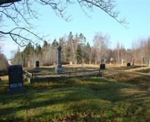 The Old Pioneer Cemetery Extension has terraced plots with beautiful old trees shading the cemetery; Grand Manan Historical Society