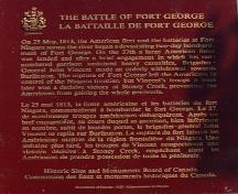 Battlefield of Fort George National Historic Site, showing the plaque text marking the north east corner of the battle site, 1989.; Parks Canada Agency/Agence Parcs Canada 1989