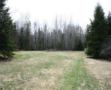 Showing approach to cemetery in wooded area; Province of PEI, Donna Collings, 2009