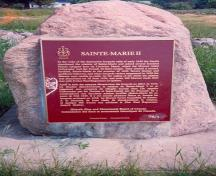 General view of the commemorative plaque located at Fort Sainte Marie II National Historic Site of Canada, 1989.; Parks Canada Agency / Agence Parcs Canada, 1989.