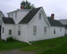 This photograph illustrates the side view of the Boone Residence, 2009; Town of St. Andrews
