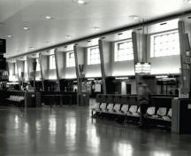 Corner view of the Canadian National Railways Central Station, showing the generous fenestration in the concourse that provides abundant natural light during the day, 1995.; Parks Canada Agency/Agence Parcs Canada, S.D. Bronson, February 1995.