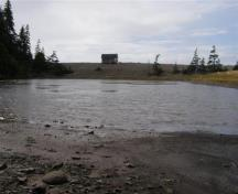 Indian Beach has a natural seawall on which the aboriginal fisherman huts were built. This image is taken from the inner shore of Indian Beach pond looking out to the seawall.; Larry Small 2009