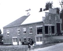 Picture of the building taken in the 1960's after it was purchased for use as the Town Hall; Doris E. Kennedy