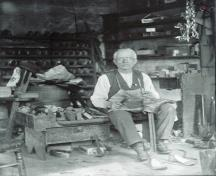 James Lawson at work on his cobbler bench; Grand Manan Archives photo collection - P40