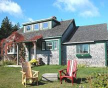 This image shows the main house of the Whale Cove Cottages where the dining hall is operated seasonally.  ; Whale Cove Cottages