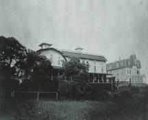 Image of the Marathon Inn taken from the western side looking east. The Captains Quarters are attached to the Annex and the Main Inn by a large boardwalk.  ; Grand Manan Archives Photo Collection