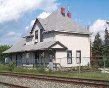 Image of train station on its original location, 2004.; Government of Saskatchewan, Town of Blaine Lake, 2004.