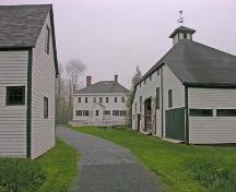 View of rear elevation of main house, barn (right) and carriage house (left), Uniacke House, Mount Uniacke, 2005.; Heritage Division, NS Dept. of Tourism, Culture and Heritage, 2005.