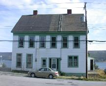 Exterior view of the front facade of the duplex at 161-163 Water Street, Harbour Grace, Newfoundland, taken summer 2004, prior to restoration.; HFNL 2005
