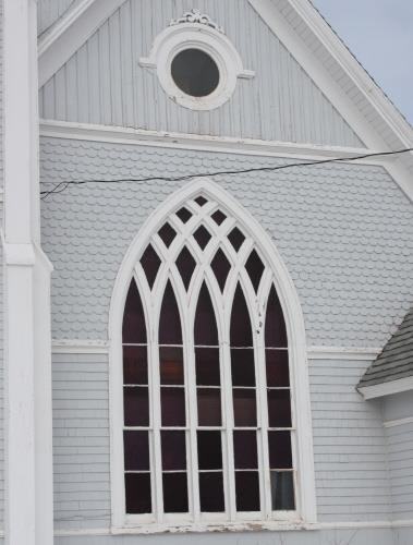 Detail of Gothic window and exterior cladding