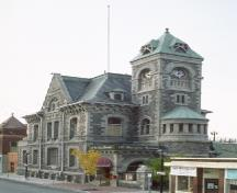 General view of the Former Galt Post Office, showing the imposing side tower with a clock and pyramidal roof.; Parks Canada Agency / Agence Parcs Canada.
