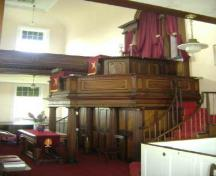 This photograph illustrates the mahogany pulpit, 2009; Town of St. Andrews