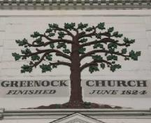 This photograph shows the Green Oak, representing Greenock, Scotland; Town of St. Andrews