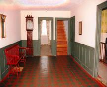 Front hall after restoration, showing grandfather clock brought with the family from New York; OHT - 2006