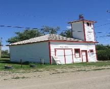 View east showing fire hall with bell tower and double doors of vehicle shed, 2004.; Government of Saskatchewan, Marvin Thomas, 2004.