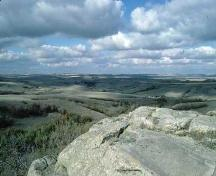 View of the surrounding landscape from the petroglyph outcrop, 1993.; Government of Saskatchewan, 1993.