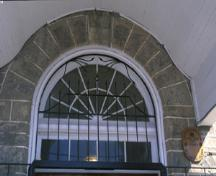 Detail view of the Former Elora Drill Shed, showing the oculus above the central entry, 1995.; Parks Canada Agency / Agence Parcs Canada, J. Butterill, 1995.