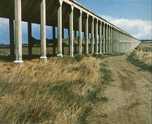 General view of Brooks Aqueduct, showing the flume and columns.; Parks Canada Agency / Agence Parcs Canada.