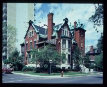 General view of the John R. Booth Residence, showing the prominent location on a corner lot, 1982.; Parks Canada Agency/ Agence Parcs Canada, 1982.