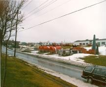 General view of Building 202 in Pleasantville to the left of the image, 1986.; Public Works and Government Services Canada / Travaux publics et Services gouvernementaux Canada, 1986.