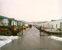 View of Building 205, seen on the right, 1987.; Travaux publics et Services gouvernementaux Canada / Public Works and Government Services Canada, 1986.