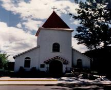 Front view of the chapel, showing its steepled entry tower, 1986.; Royal Canadian Mounted Police / Gendarmerie royale du Canada, 1986.