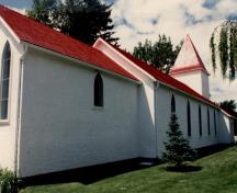 Side view of the chapel, showing the regularly arranged tall, pointed windows, 1986.; Royal Canadian Mounted Police / Gendarmerie royale du Canada, 1986.