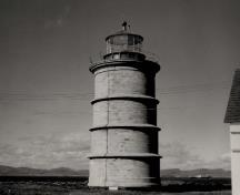General view of the Lighthouse, showing the stone masonry construction of smooth, dressed ashlar stone, circa 1975.; Transport Canada / Transports Canada, circa/vers 1975.