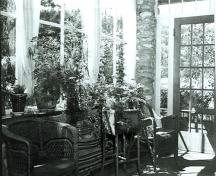 Interior view of the Jackman Residence, showing the interior sunroom, 1988.; Jasper National Park of Canada / Parc national du Canada Jasper, 1988.