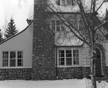 Façade of the Superintendent's Residence, showing the multi-paned windows of different shapes and sizes and the fieldstone chimney, 1989.; George A. Armstrong, 1989.