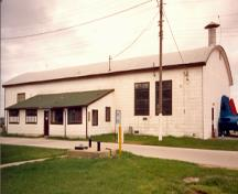 General view of Hangar 13, showing the lean-to shed on its eastern façade, 1992.; Department of National Defence / ministère de la Défense nationale, 1992.