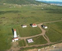 Aerial view of Cape Anguille Light Tower, showing its focal and dominant presence within the lightstation, 2000.; Department of Fisheries and Oceans / Ministères des Pêches et Océans, 2000.