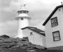 Lobster Cove Head Lighthouse, showing the lightkeeper's house, 1988.; Parks Canada Agency/Agence Parcs Canada, 1988.