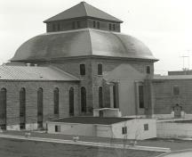 View of the Main Cellblock's dome, showing the mansard roof topped by a roofed monitor, 1990.; Parks Canada Agency / Agence Parcs Canada, 1990.
