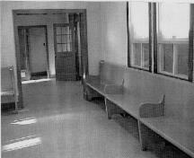 Public waiting room, showing the original wooden benches, 1999.; Parks Canada Agency/ Agence Parcs Canada, 1999.