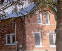 Corner view of Former Miller Residence, showing the dichromatic brickwork, 2005.; Department of Public Works and Government Services / Ministère des Travaux publics et services gouvernementaux, 2005.